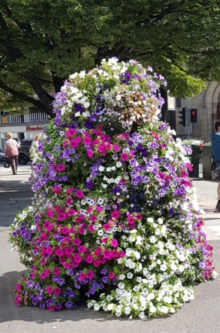 Summer flowers in tiered planter